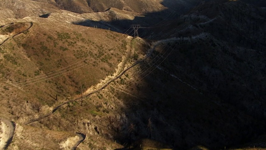 Approach power lines along low mountain ridge, San Gabriel Mountains, California Aerial Stock Footage | AF0001_000472