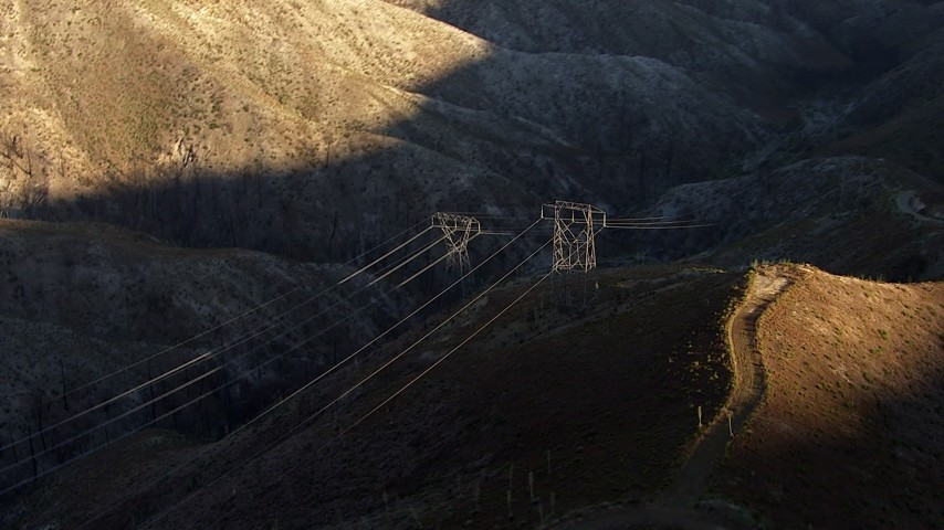 HD stock footage aerial video zoom in to a closer view of power lines in the San Gabriel Mountains, California Aerial Stock Footage | AF0001_000473