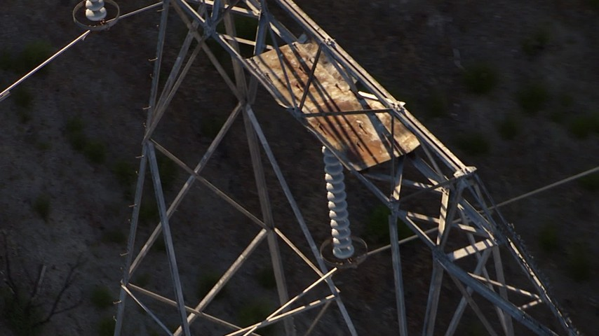 HD stock footage aerial video orbiting the top of a power line tower, zoom to a wider view, San Gabriel Mountains, California Aerial Stock Footage | AF0001_000474