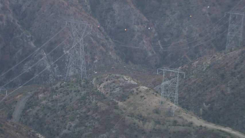 HD stock footage aerial video of power lines spanning a mountain canyon in the San Gabriel Mountains, California Aerial Stock Footage | AF0001_000477