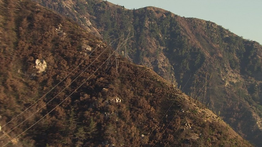 HD stock footage aerial video of power lines on a mountain slope in the San Gabriel Mountains, California Aerial Stock Footage | AF0001_000479