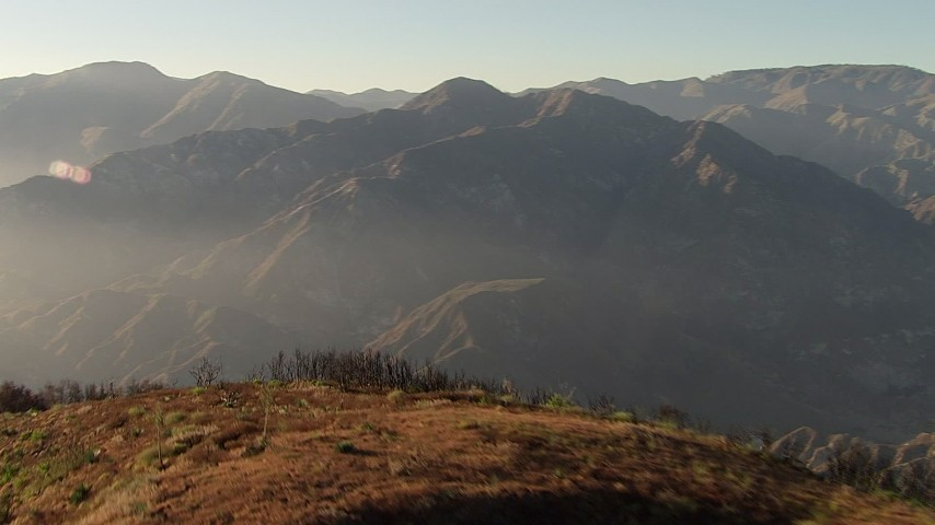 HD stock footage aerial video fly over a ridge to approach a peak in the San Gabriel Mountains, California Aerial Stock Footage | AF0001_000481