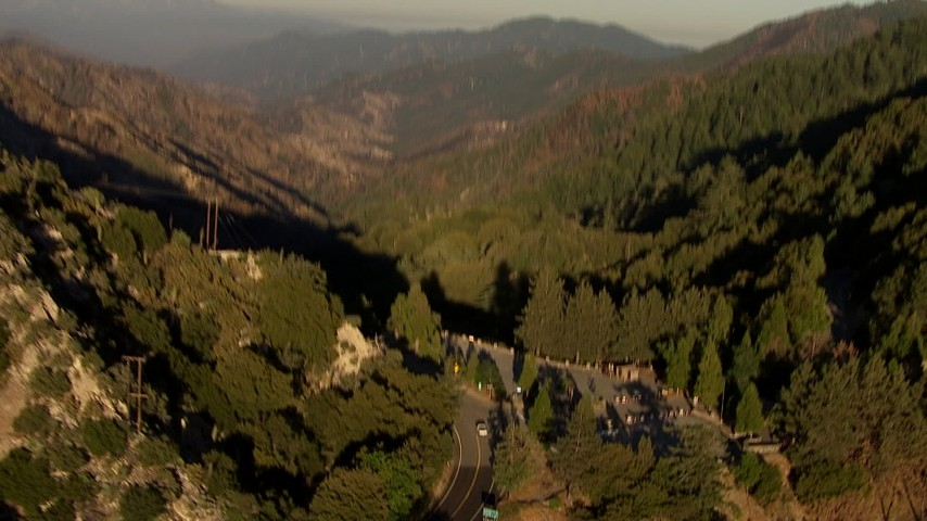 HD stock footage aerial video fly over a canyon and pan to reveal radio towers on Mount Wilson, San Gabriel Mountains, California, sunset Aerial Stock Footage | AF0001_000488