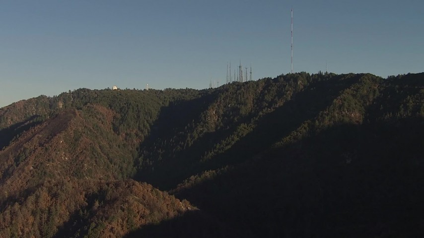 HD stock footage aerial video approach the observatory and radio towers in Mount Wilson, San Gabriel Mountains, California, sunset Aerial Stock Footage | AF0001_000489