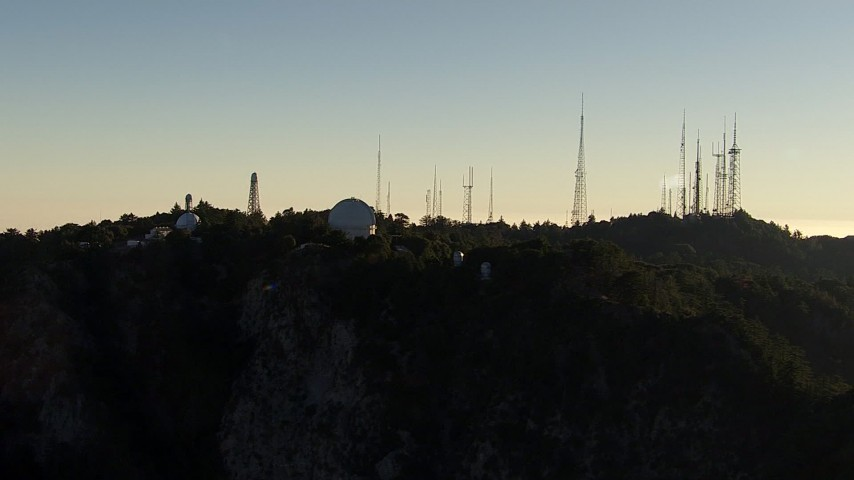 HD stock footage aerial video flyby the Mount Wilson Observatory and radio towers in the San Gabriel Mountains, California, twilight Aerial Stock Footage | AF0001_000494