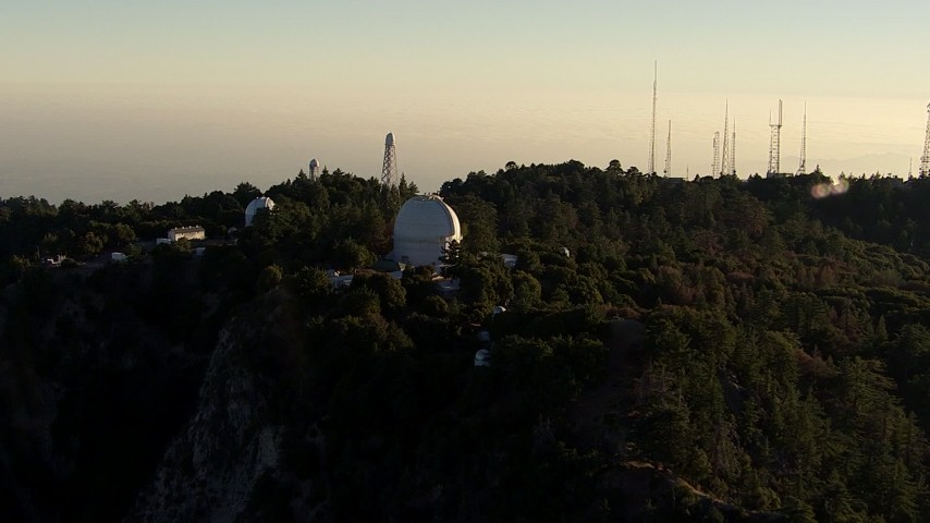HD stock footage aerial video approach and flyby the Mount Wilson Observatory and radio towers, San Gabriel Mountains, California, sunset Aerial Stock Footage | AF0001_000495