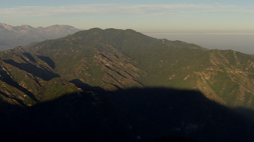 HD stock footage aerial video pan across a peak in the San Gabriel Mountains, California, sunset Aerial Stock Footage | AF0001_000497