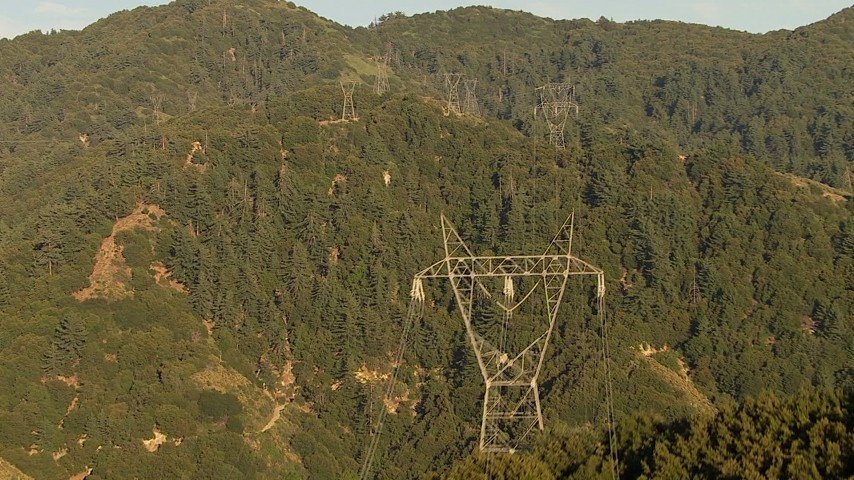 HD stock footage aerial video follow power lines up a mountain in the San Gabriel Mountains, California, sunset Aerial Stock Footage | AF0001_000500