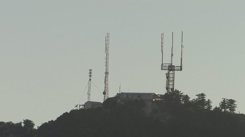 A mountaintop radio transmission station, San Gabriel Mountains, California, sunset Aerial Stock Footage | AF0001_000504