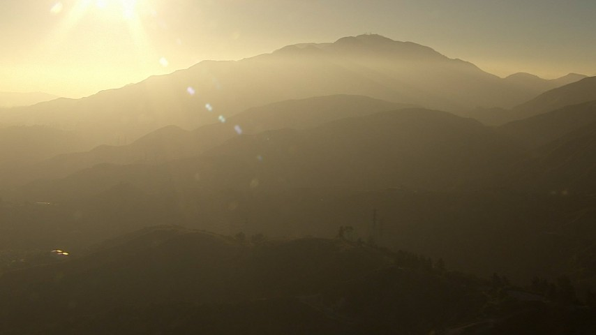 HD stock footage aerial video approach the hazy San Gabriel Mountains, California, sunset Aerial Stock Footage | AF0001_000509