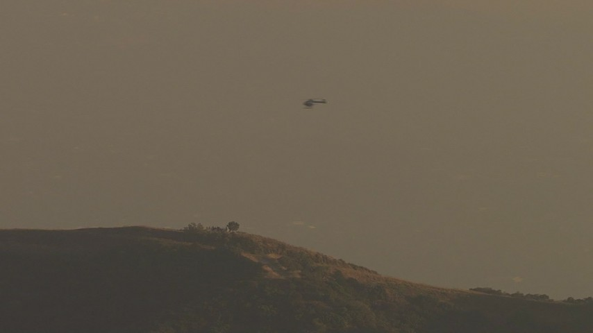 HD stock footage aerial video of tracking helicopter flying over Verdugo Mountains, Tujunga, California, twilight Aerial Stock Footage | AF0001_000516