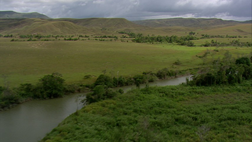 HD stock footage aerial video follow a narrow river through green savanna, Southern Venezuela Aerial Stock Footage | AF0001_000522
