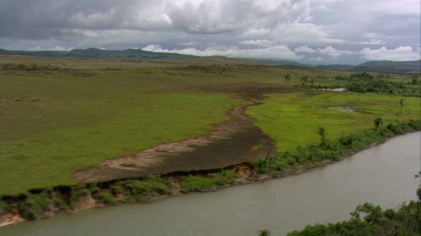 HD stock footage aerial video of a narrow river and wide green savanna, Southern Venezuela Aerial Stock Footage | AF0001_000524