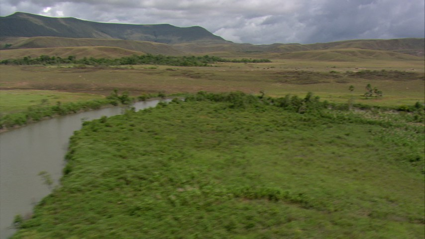 A bend in the river surrounded by green savanna, Southern Venezuela Aerial Stock Footage | AF0001_000525