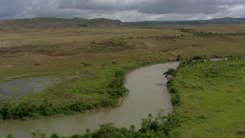 HD stock footage aerial video pan across a river running through savanna, Southern Venezuela Aerial Stock Footage | AF0001_000526