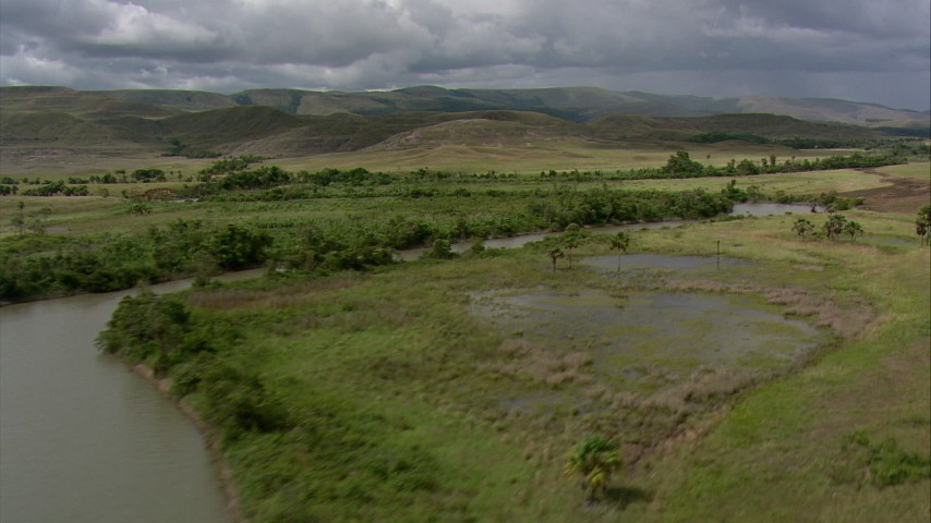 Flyby a river winding through savanna near hills in Southern Venezuela Aerial Stock Footage | AF0001_000534