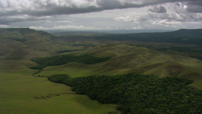 Flyby green mountains and hills in Southern Venezuela Aerial Stock Footage | AF0001_000552