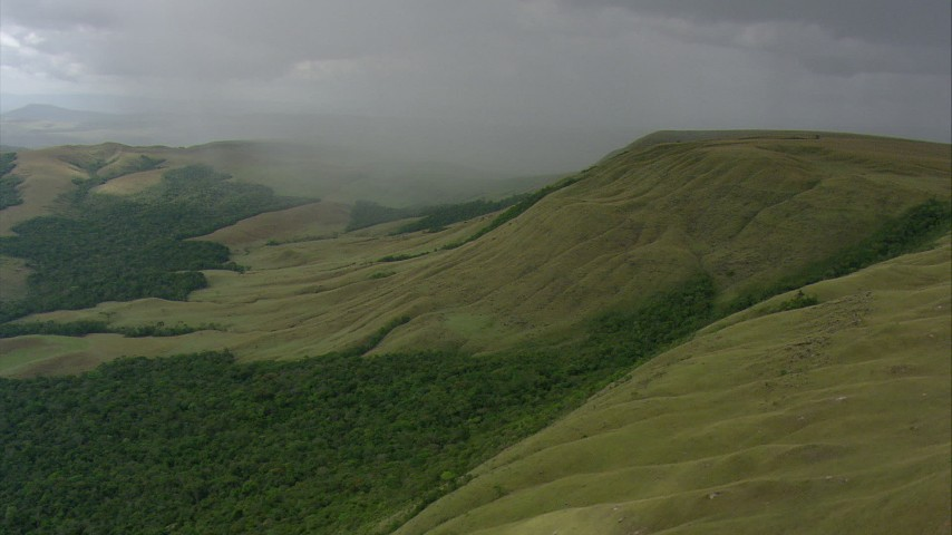 HD stock footage aerial video of rain on a green mountain and tilt down to jungle in Southern Venezuela Aerial Stock Footage | AF0001_000555