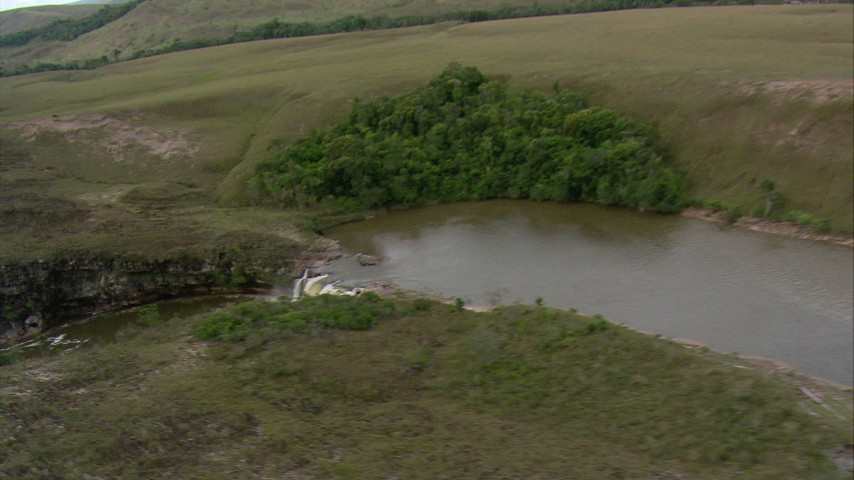 Track a waterfall on a river in Southern Venezuela Aerial Stock Footage | AF0001_000559