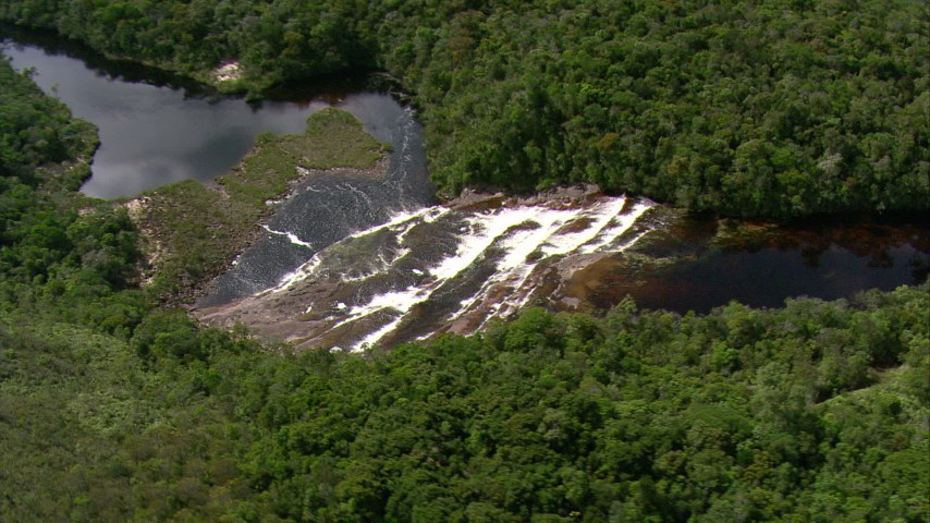 HD stock footage aerial video of a river waterfall beside jungle trees in Southern Venezuela Aerial Stock Footage | AF0001_000565