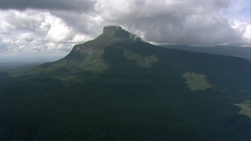 HD stock footage aerial video of clouds over jungle and a Guiana Highlands mountain peak in Southern Venezuela Aerial Stock Footage | AF0001_000570