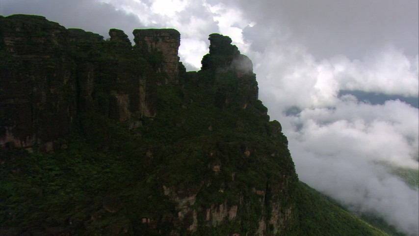 HD stock footage aerial video of rugged peak with jungle vegetation in the Guiana Highlands, Southern Venezuela Aerial Stock Footage | AF0001_000589