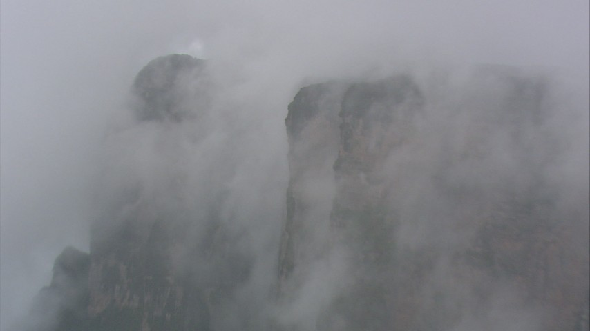 HD stock footage aerial video of misty clouds around steep cliffs in Southern Venezuela Aerial Stock Footage | AF0001_000598