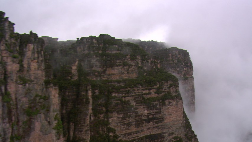 Flyby steep mountain cliffs in the rain in Southern Venezuela Aerial Stock Footage | AF0001_000600