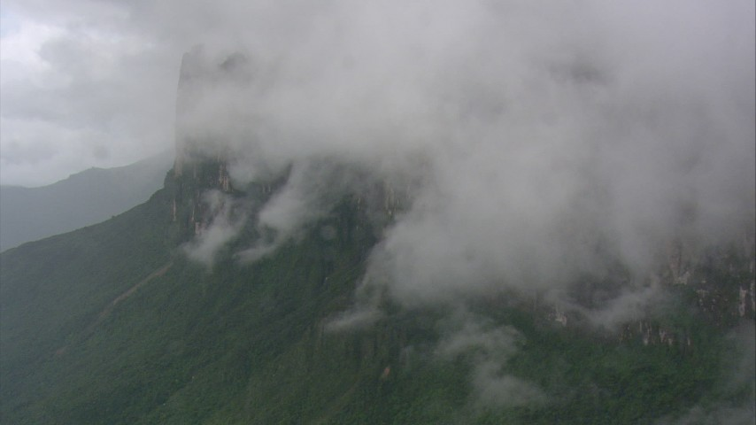 HD stock footage aerial video of flying away from mist-shrouded mountain, Southern Venezuela Aerial Stock Footage | AF0001_000603