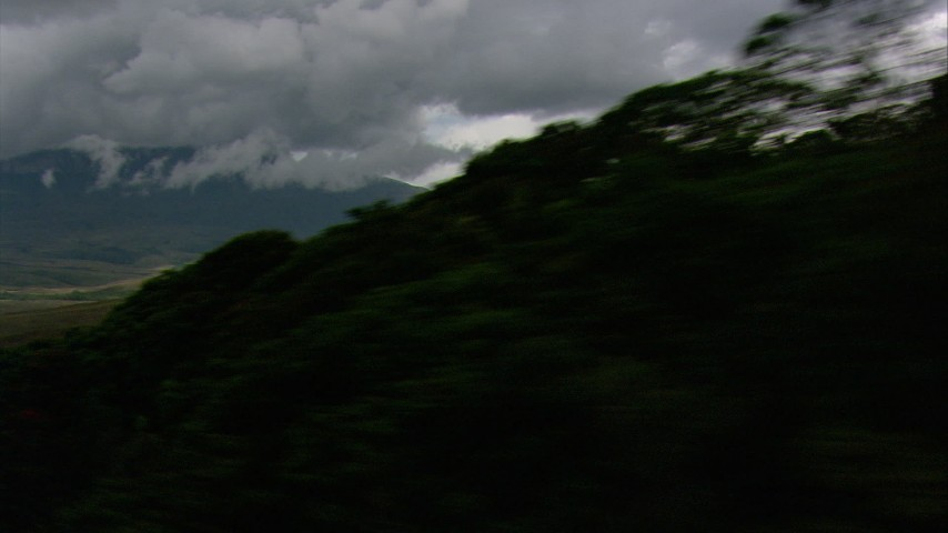 HD stock footage aerial video zoom wider to a view of dense clouds, hilly savanna, reveal jungle and mountains in Southern Venezuela Aerial Stock Footage | AF0001_000622