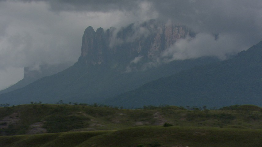 HD stock footage aerial video of a mountain partially hidden by dense cloud cover in Southern Venezuela Aerial Stock Footage | AF0001_000627