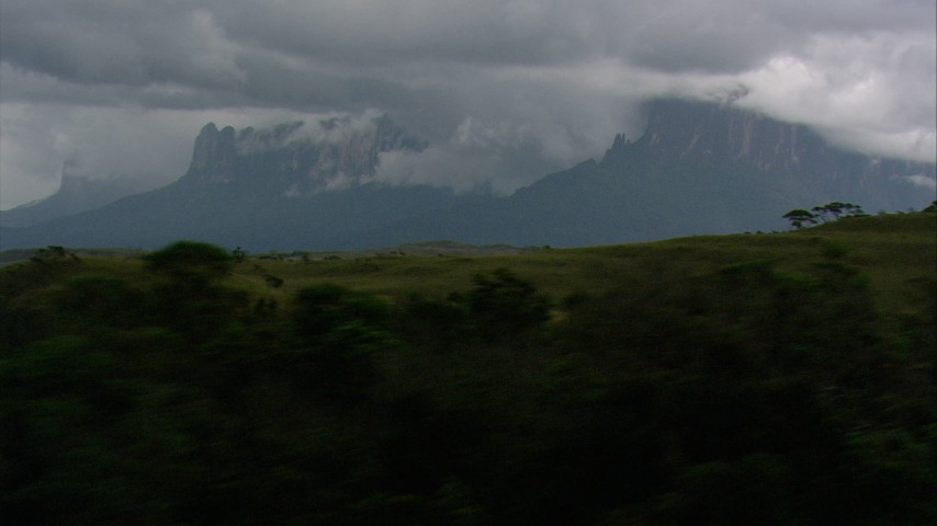 HD stock footage aerial video of cloud-covered mountains seen from hills and jungle in Southern Venezuela Aerial Stock Footage | AF0001_000630