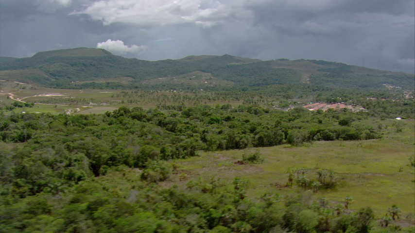 HD stock footage aerial video of rural homes and trees near green mountains in Southern Venezuela Aerial Stock Footage | AF0001_000638