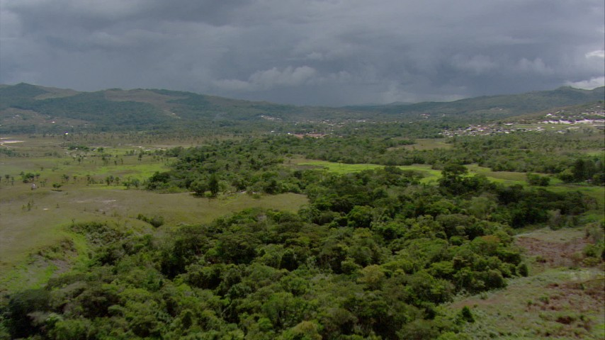 HD stock footage aerial video of a reverse view of green mountains and a small rural town in Southern Venezuela Aerial Stock Footage | AF0001_000639