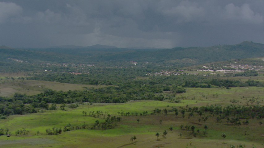 Zoom out from a hotel to reveal a small town and rural homes in Southern Venezuela Aerial Stock Footage | AF0001_000640