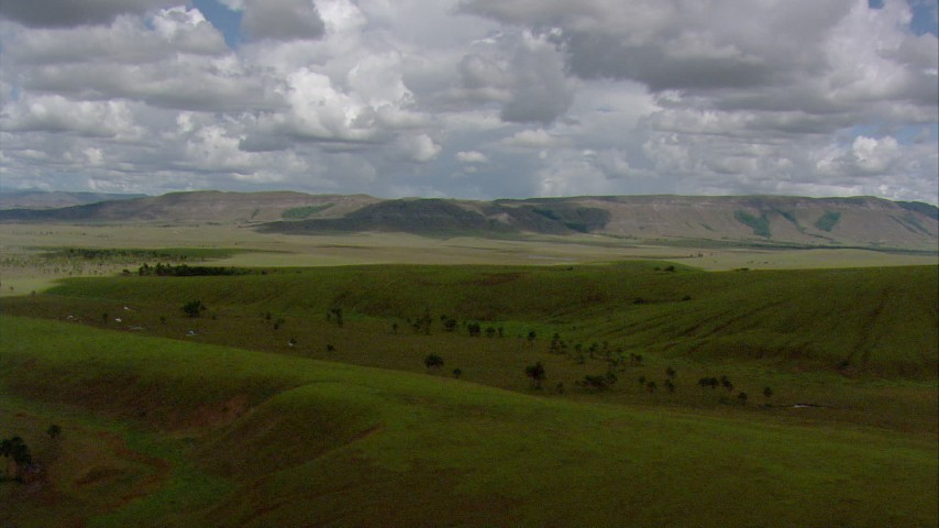 HD stock footage aerial video of a view of mountains across a savanna, Southern Venezuela Aerial Stock Footage | AF0001_000644