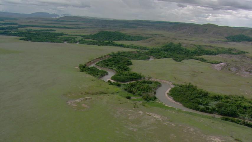Following a river through savanna in Southern Venezuela Aerial Stock Footage | AF0001_000655