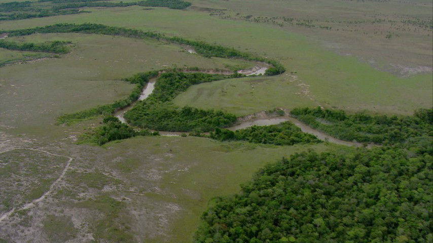 HD stock footage aerial video follow and flyby a river cutting through savanna, Southern Venezuela Aerial Stock Footage | AF0001_000657