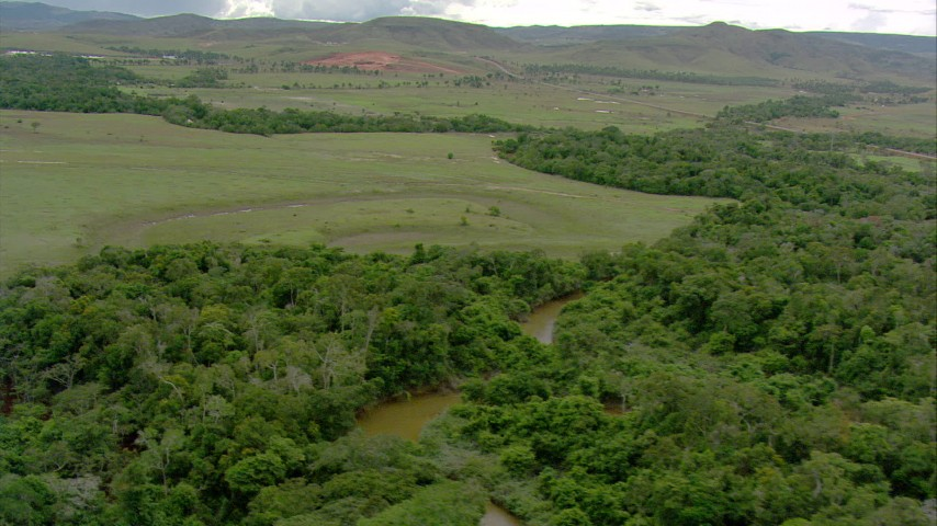 Pan across a river cutting through jungle in Southern Venezuela Aerial Stock Footage | AF0001_000665