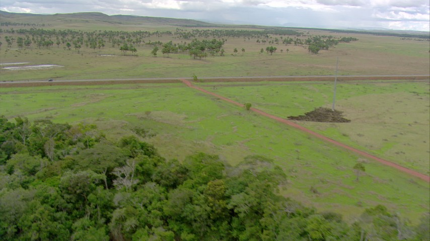 HD stock footage aerial video of a dirt road leading to a country highway in Southern Venezuela Aerial Stock Footage | AF0001_000667