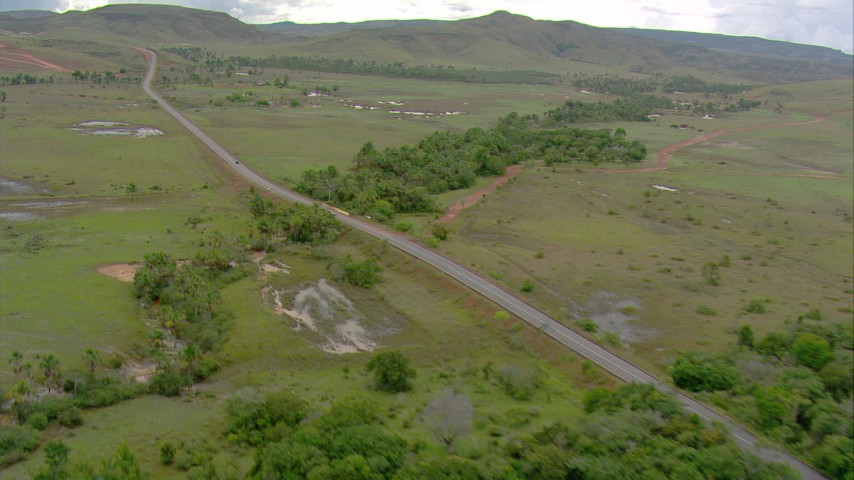 Pan across a country highway through savanna, Southern Venezuela Aerial Stock Footage | AF0001_000668