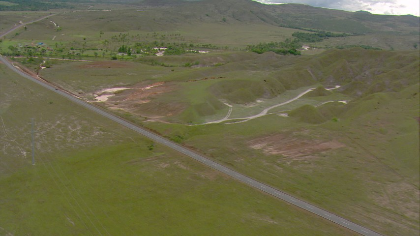 A country highway through savanna and small bridge spanning a river in Southern Venezuela Aerial Stock Footage | AF0001_000672