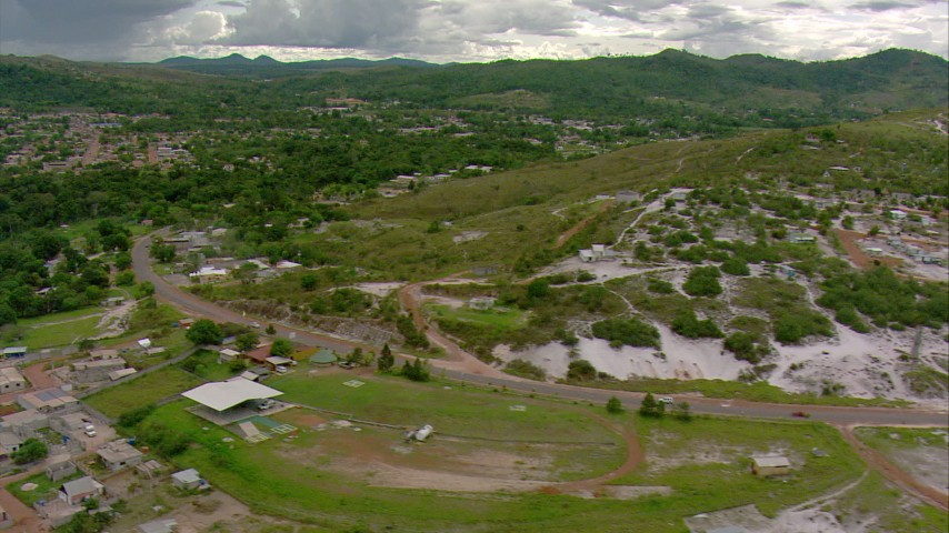 HD stock footage aerial video follow a highway through a small town in Southern Venezuela Aerial Stock Footage | AF0001_000677