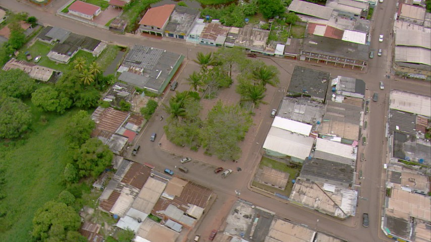 HD stock footage aerial video tilt to a bird's eye view of a park in a small town in Southern Venezuela Aerial Stock Footage | AF0001_000681
