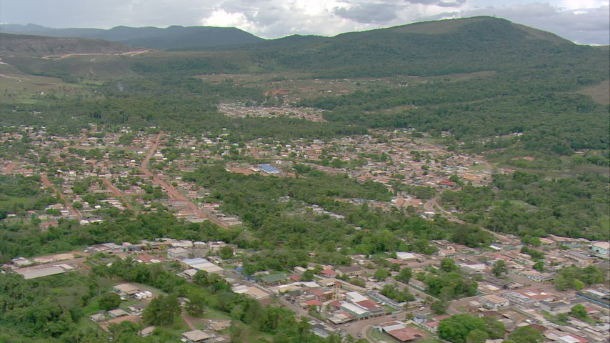 HD stock footage aerial video tilt from a small town to reveal mountains in Southern Venezuela Aerial Stock Footage | AF0001_000682