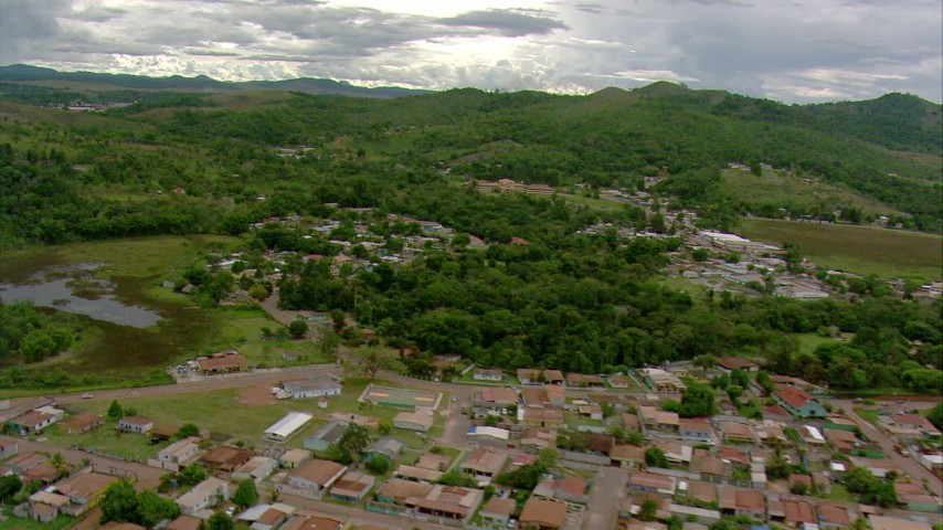 HD stock footage aerial video fly over homes in a small town to approach a hotel in Southern Venezuela Aerial Stock Footage | AF0001_000687