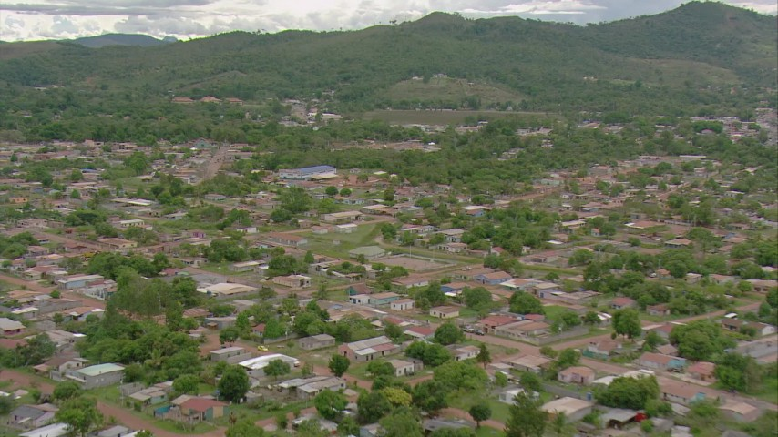 A reverse view of neighborhoods in a small town in Southern Venezuela Aerial Stock Footage | AF0001_000690