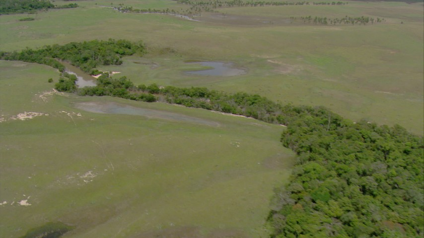 HD stock footage aerial video pan across river through the jungle and ponds in Southern Venezuela Aerial Stock Footage | AF0001_000691
