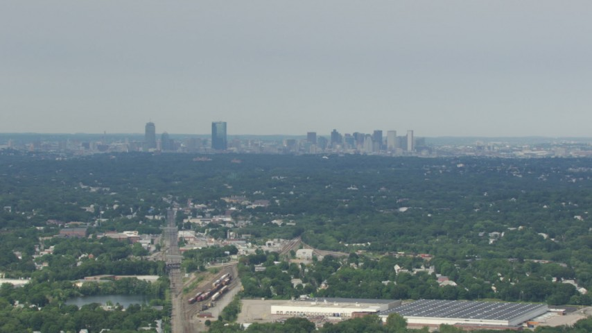 Approaching Downtown Boston skyline from Readville, Massachusetts Aerial Stock Footage | AF0001_000696