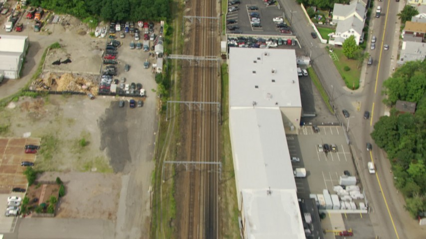 HD stock footage aerial video of a bird's eye view of train tracks through Hyde Park, Massachusetts Aerial Stock Footage | AF0001_000700